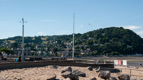 People in Minehead. Minehead, UK - July 27, 2016:   View of Minehead Somerset England UK beach and seafront towards the harbour and view of the North Hill Royalty Free Stock Photo