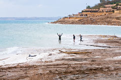 People in mineral mud in Dead Sea, Jordan Stock Image
