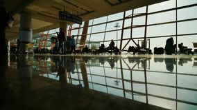 People at a modern airport, departure lounge. stock photos
