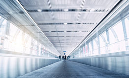 People in speed on a skywalk Royalty Free Stock Photo