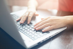 People and modern technology concept. Close up shot of female hands typing on keyboard of her laptop. Young businesswoman working. On notebook computer at royalty free stock photo