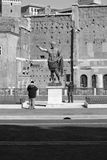 People monumental statues. Tourists and monumental artistic statues in the city center of Rome Royalty Free Stock Photos