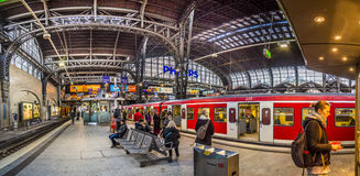 People in the morning wait for the train in the central station Royalty Free Stock Photography