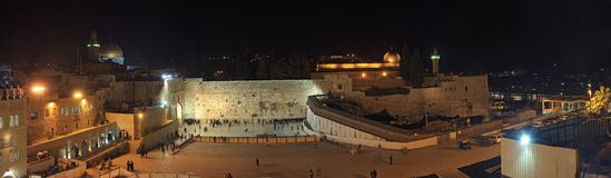 People, mostly soldiers praying at the holiest Jewish site - Western/Wailing wall at night Stock Images