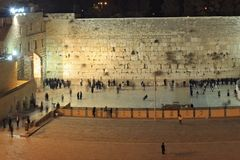 People, mostly soldiers praying at the holiest Jewish site - Western/Wailing wall at night Stock Photography