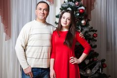 People, motherhood, family, christmas and adoption concept - happy father and daughter hugging at home royalty free stock images