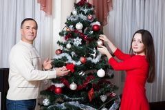 People, motherhood, family, christmas and adoption concept - happy father and daughter hugging at home. Christmas family royalty free stock image