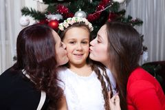 People, motherhood, family, christmas and adoption concept - happy mother and daughter hugging at home stock images
