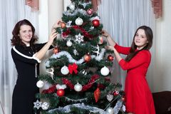 People, motherhood, family, christmas and adoption concept - happy mother and daughter hugging at home stock image