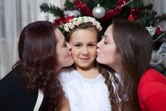 People, motherhood, family, christmas and adoption concept - happy mother and daughter hugging at home royalty free stock images