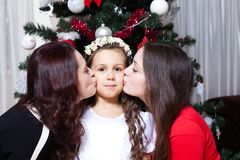 People, motherhood, family, christmas and adoption concept - happy mother and daughter hugging at home royalty free stock photography