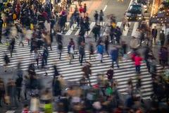 People in motion blur crossing street in Shibuya. Tokyo royalty free stock image