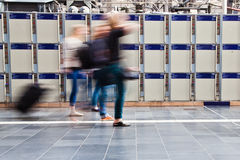 People in motion blur in front of lockers Stock Image