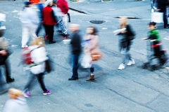 People in motion blur on the move in the city Stock Image