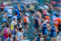 People in motion blur running paris marathon france Stock Photos