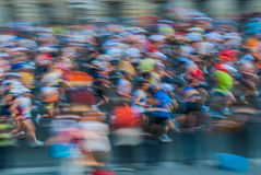 People in motion blur running paris marathon france Stock Photography