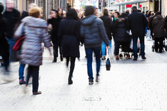 People in motion blur in the shopping street Royalty Free Stock Images