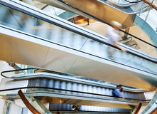 People in motion in escalators. At the modern shopping mall Royalty Free Stock Photography