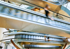 People in motion in escalators. At the modern shopping mall Stock Image