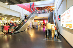 People in motion in escalators at the modern shopping mall Royalty Free Stock Photography