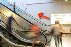 People in motion in escalators at the modern shopping mall Royalty Free Stock Photo
