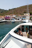 People With Motor Boat, Capraia Island Royalty Free Stock Photos