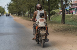 People on motorbike in street and countryside in Siem Reap Stock Images