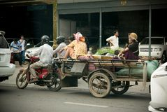 People on the motorbike on the streets of Phnom Penn in Cambodia Royalty Free Stock Photo