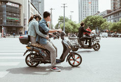 People on motorbikes on street it Xian, China Royalty Free Stock Images