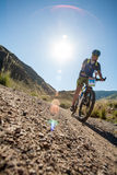 People in the mountains on a bike races to victory stock image