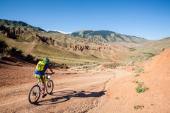 People in the mountains on a bike races to victory royalty free stock photos