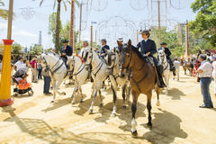 People mounted on horse in Fair Royalty Free Stock Image