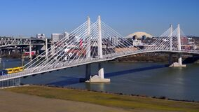 People Move Across Portland Bridge Willamette River Mount St Helens. It`s a clear day in Portland Oregon at Tilikum Crossing as people traverse the river with stock video footage