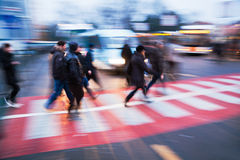 People on the move at a bus station. The picture was taken by panning the camera with long exposure Royalty Free Stock Images