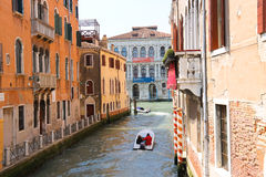 People move through the channel on the boat in Venice, Italy Royalty Free Stock Image
