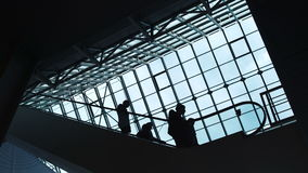 People move on an escalator in a building stock video footage