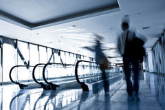 People move in glass corridor royalty free stock photo