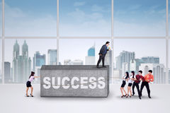 People move an obstacle to success Stock Image