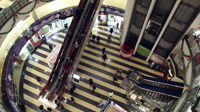 People move up and down the escalators stock footage