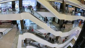 People Are Moved On The Escalator At The Business Shopping Center. Moving  Staircase Of Escalator