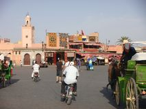 People in movement in the traffic of  the city of Marakkech in maroc. City square with traffic of Marakkech in Maroc. People in movement. Men with mopeds. Men Stock Photo