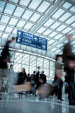 People moving blur in modern airport hall Stock Images