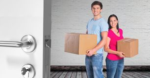 people moving boxes into new home Royalty Free Stock Photography