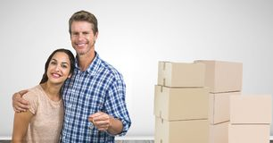 people moving boxes into new home Royalty Free Stock Photo