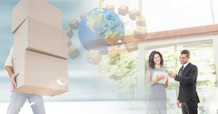 People moving boxes into new home with key Stock Image