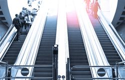 People moving in escalator Royalty Free Stock Photography