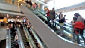 People on moving escalators at modern shopping mall, Hong Kong stock footage