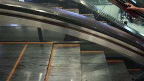 People moving on escalators in SUVARNABHUMI AIRPORT ,Thailand stock footage