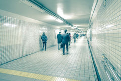 People moving fast through a subway Royalty Free Stock Photos