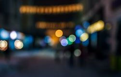 People moving on old city winter night street blurred. People moving on the old european city winter night street defocused blurred abstract image stock photo